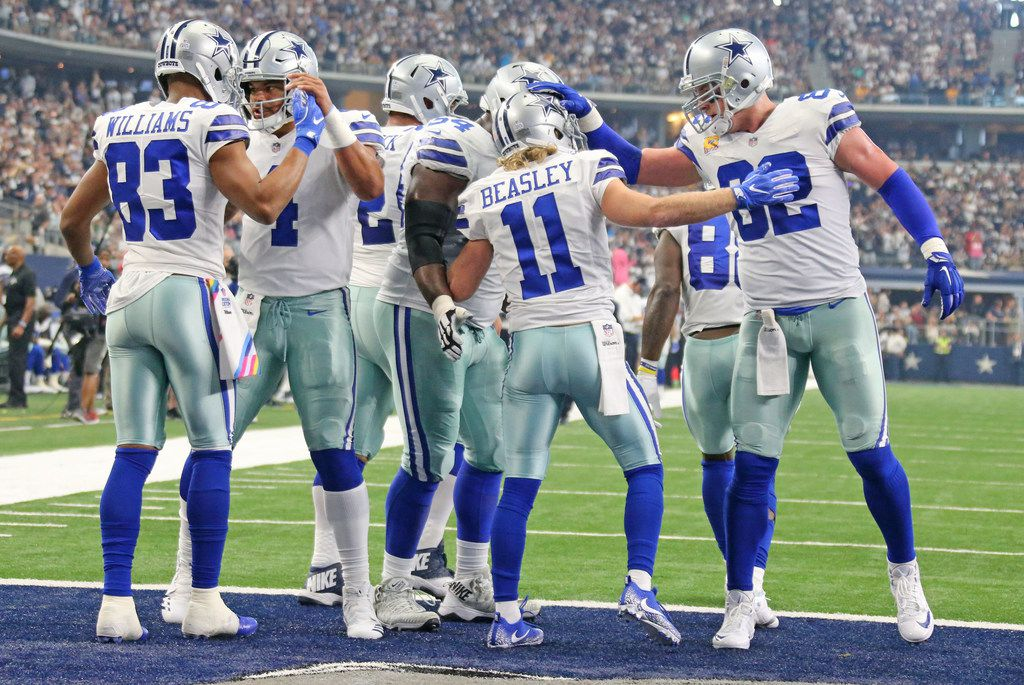 Dallas Cowboys Terrance Williams (83), Dak Prescott (4), Cole Beasley (11) and Jason Witten (82) celebrate Beasley's first-quarter touchdown pass during the Green Bay Packers vs. the Dallas Cowboys NFL football game at AT&T Stadium in Arlington, Texas on Sunday, October 8, 2017. (Louis DeLuca/The Dallas Morning News)