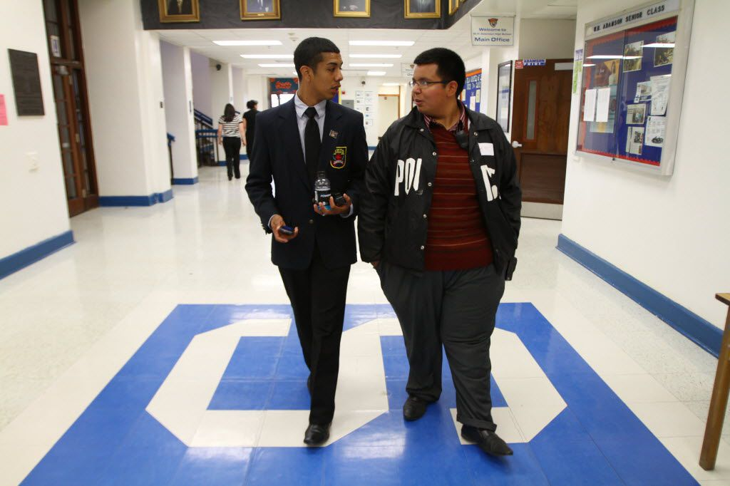 """In 2011, Adan Gonzalez, then class president of Adamson High School, patrolled the school as """"principal for the day."""" With him is his friend Luis Retta. (File Photo/The Dallas Morning News)"""