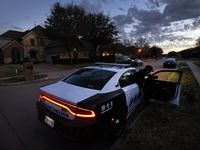 Dallas Police sit outside Eboni Samuel and Bryan Riser's home as an FBI Evidence Response Team goes through their south Grand Prairie, Texas home, Thursday, March 4, 2021. Riser, a Dallas Place officer, has been arrested and charged with two counts of murder. (Tom Fox/The Dallas Morning News)