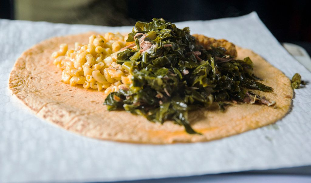 "A ""Soul Food Burrito"" at Brunchaholics booth at the Dallas Farmers Market in Dallas on Saturday, March 30, 2019. The burrito consists of macaroni and cheese, collard greens with smoked turkey, fried catfish and it is held together by a jalape–o cheddar wrap. (Daniel Carde/The Dallas Morning News)"