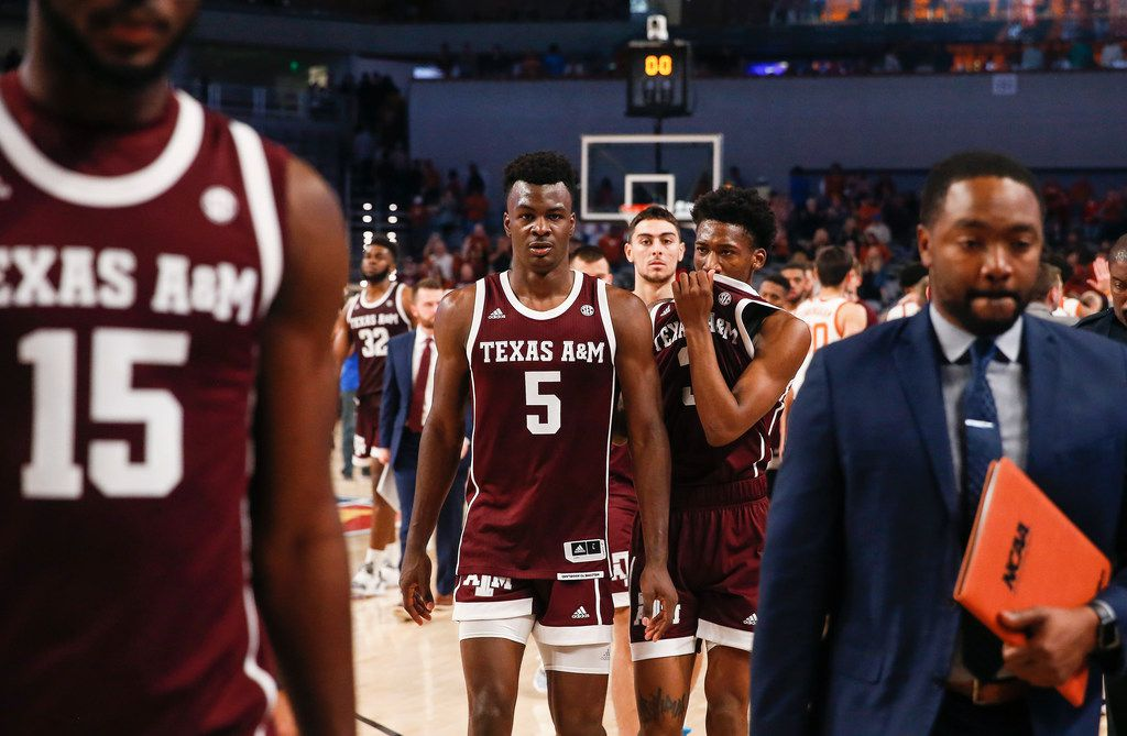 Texas A&M Aggies forward Emanuel Miller (5) and guard Quenton Jackson (3) exit the court following a loss in a basketball matchup between the Texas Longhorns and Texas A&M Aggies in the Lone Star Showdown on Sunday, Dec. 8, 2019 at Dickies Arena in Fort Worth, Texas. (Ryan Michalesko/The Dallas Morning News)