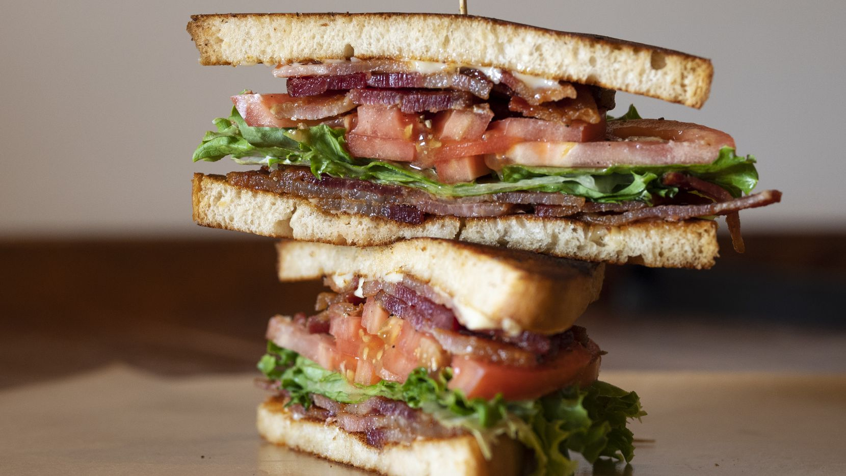 The classic BLT, bacon, lettuce, tomato, with mayo on griddled white bread, from at Goodfriend Package restaurant in Dallas, on June 29, 2021.