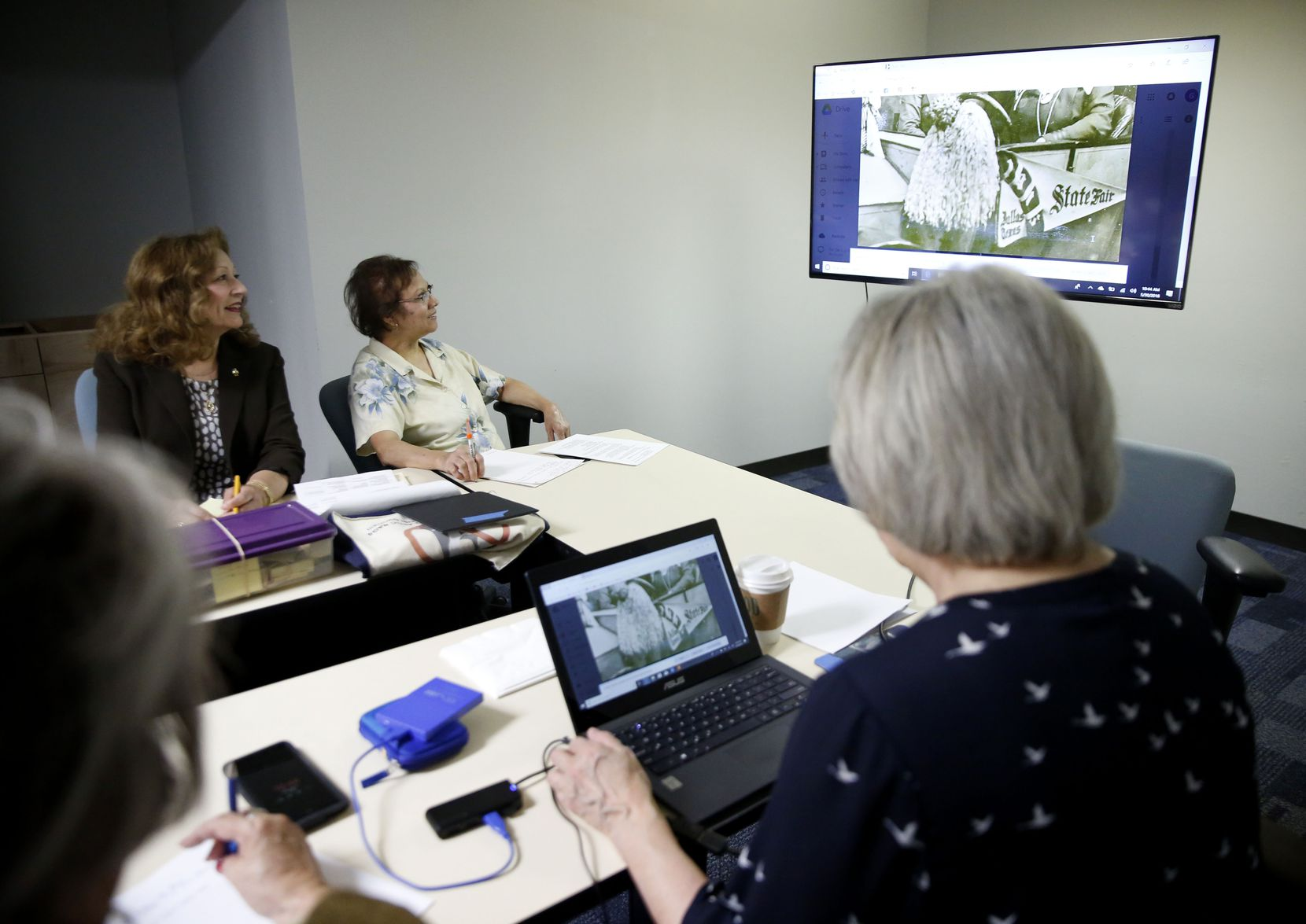 Members of the Dallas Mexican American Historical League sort through archived photos while planning  exhibits for the Latino Cultural Center and State Fair of Texas.