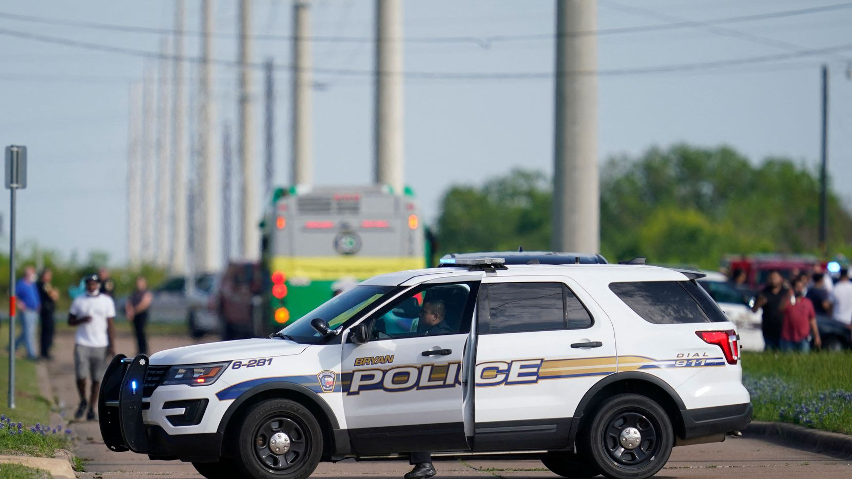 A Bryan police officer blocks road access near the scene of a mass shooting at an industrial park on Thursday.