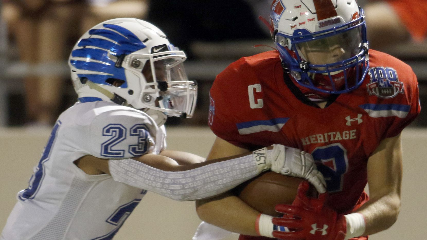 Midlothian Heritage running back Cullen Stone (2) works to protect the ball as he is tackled by Lindale defensive back Arik Williams (23) following a long ground gainer which set up a second quarter Jaguars touchdown. The two teams played their Class 4A football game at Midlothian ISD Multipurpose Stadium in Midlothian on September 4, 2020.