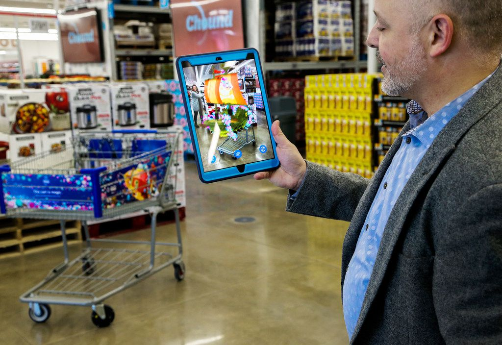 Eddie Garcia, vice president of end-to-end experience at Sam's Club, demonstrates features customers can use while shopping at Sam's Club Now on lower Greenville Avenue in Dallas. The technology-incubator warehouse opens Friday.