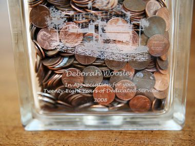 Deborah Woosley and her husband, Richard, were educators for a combined 64 years. She was given a glass bank as a retirement gift from Waxahachie ISD, where she keeps pennies.