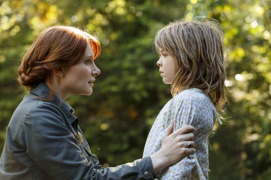 "This image released by Disney shows Bryce Dallas Howard, left, and Oakes Fegley in a scene from ""Pete's Dragon."""