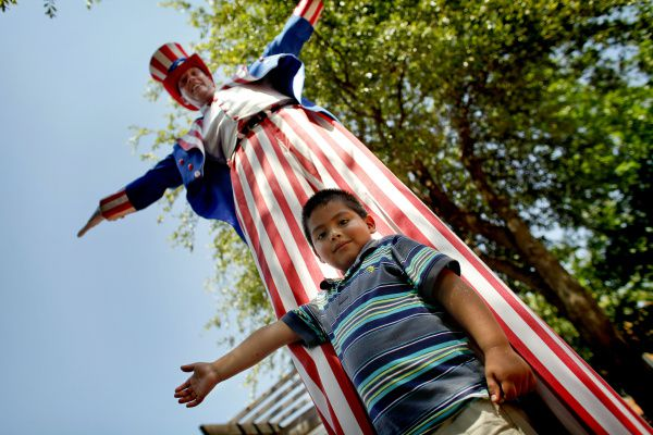 Luis Guerrero mimics Brad Johnson, who is portraying a very tall version of Uncle Sam, at Firewheel Town Center's annual Fourth of July celebration in Garland.
