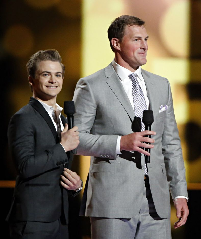 Hunter Hayes (left) and Dallas Cowboys tight end Jason Witten appear on stage during the 2015 Academy of Country Music Awards Sunday, April 19, 2015 at AT&T Stadium in Arlington, Texas.