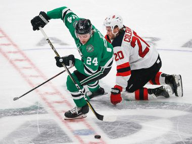 FILE - Stars left wing Roope Hintz (24) steals the puck from New Jersey Devils center Blake Coleman (20) during the third period of a game on Tuesday, Dec. 10, 2019, at American Airlines Center in Dallas.
