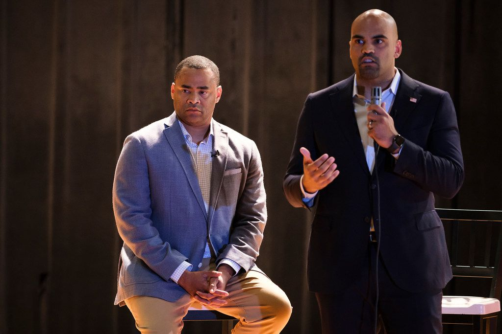 Rep. Marc Veasey, D-Fort Worth, listens as Rep. Colin Allred, D-Dallas, speaks at a joint town hall event at North Dallas High School on May 28, 2019, in Dallas.