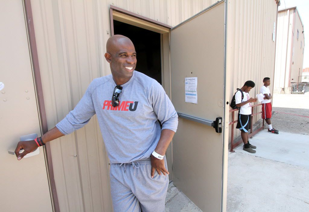 Football Hall of Famer Deion Sanders was all smiles moments after concluding a meeting with his players at the Prime Prep Academy, a charter school he started in Oak Cliff in 2012. The school would shut down in scandal after 2 1/2 year and is still facing lawsuits. (Steve Hamm/Dallas Morning News Special Contributor)