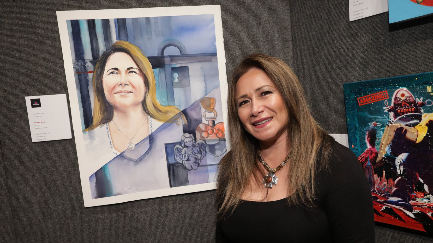 A former client of the Human Rights Initiative of North Texas poses with a portrait inspired by her story. It was created by artist Manal Fashi for Rock Your Heart Out 2018.