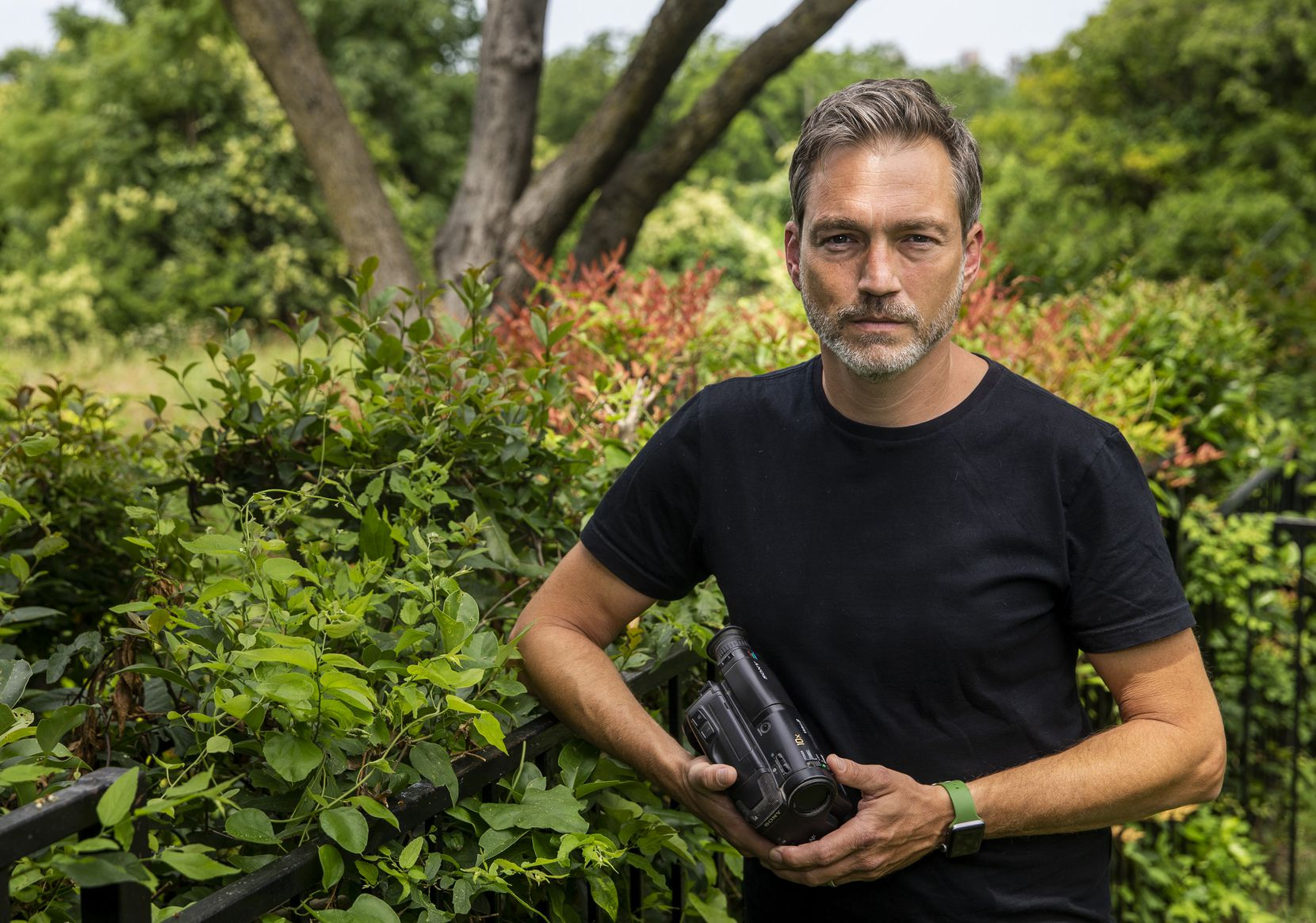"""Filmmaker Miles Hargrove holds the Sony Video8 camcorder he used to film the 25-year-old footage in his new film, """"Miracle Fishing."""""""