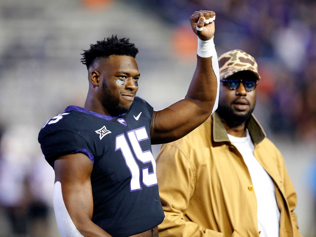 TCU Horned Frogs defensive end Ben Banogu (15) waves as he's introduced during Senior Night before their game against the Oklahoma State Cowboys at Amon G. Carter Stadium in Fort Worth, Texas, Saturday, November 24, 2018. (Tom Fox/The Dallas Morning News)