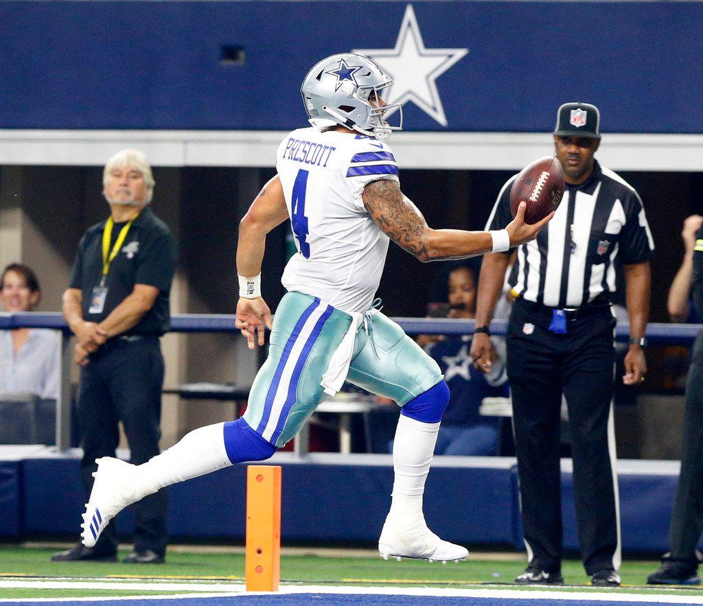 Dallas Cowboys quarterback Dak Prescott (4) strides across the goal line for a first quarter touchdown against the Jacksonville Jaguars at AT&T Stadium in Arlington, Texas, Sunday, October 14, 2018. (Tom Fox/The Dallas Morning News)