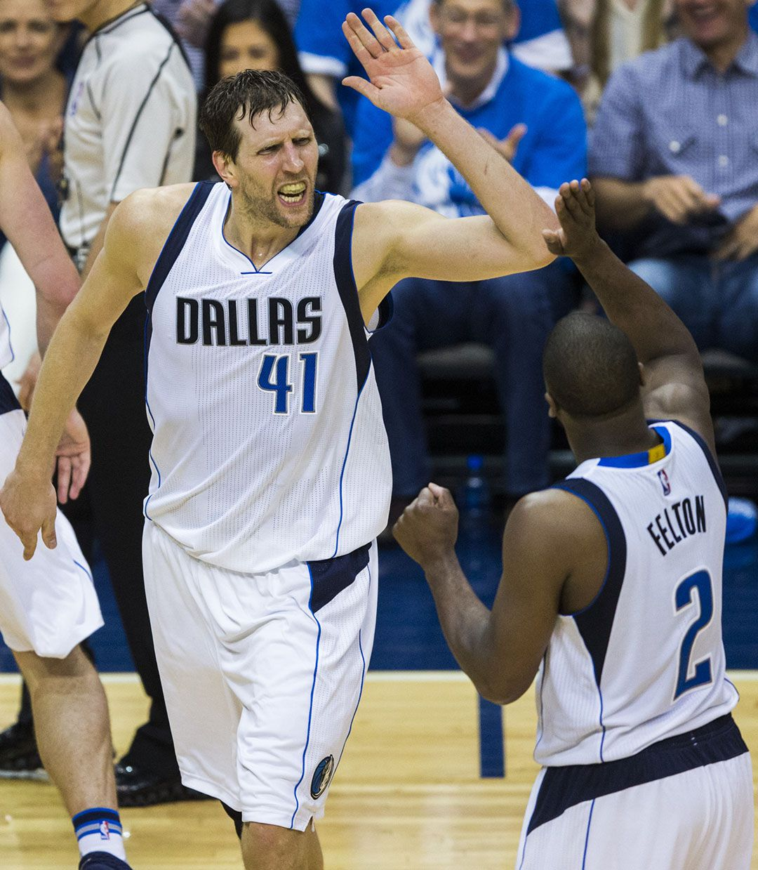Dallas Mavericks forward Dirk Nowitzki (41) high-fives guard Raymond Felton (2) during the fourth quarter of game 4 of their series against the Oklahoma City Thunder in the first round of NBA playoffs on Saturday, April 23, 2016 at the American Airlines Center in Dallas.  (Ashley Landis/The Dallas Morning News)