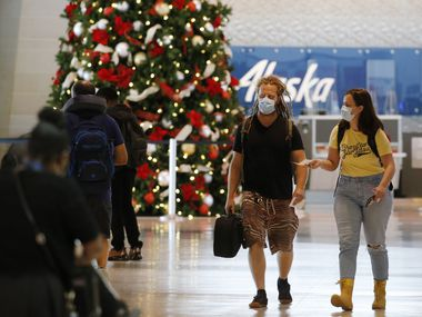 Passengers make their way through the airport near the security checkpoint at Dallas Love Field airport in Dallas on Nov. 10.