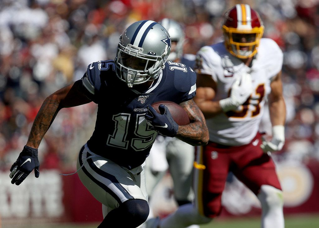 LANDOVER, MARYLAND - SEPTEMBER 15: Wide receiver Devin Smith #15 of the Dallas Cowboys carries the ball upfield following a reception against the Washington Redskins during second half action at FedExField on September 15, 2019 in Landover, Maryland. The Cowboys won the game 31-21. (Photo by Win McNamee/Getty Images)