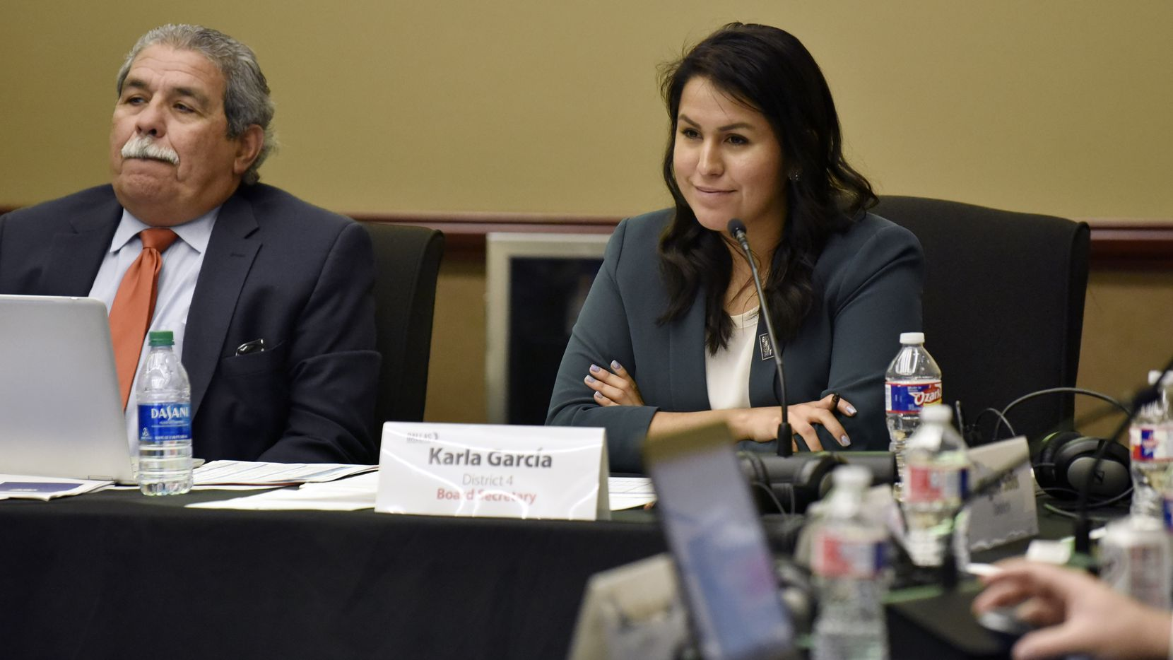 DISD board trustee Karla Garcia of District 4 listened to a presentation with Superintendent Michael Hinojosa during a Dec. 5 meeting at the Dallas County Schools Technology and Training Center.