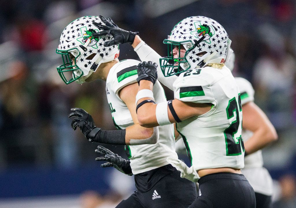 Southlake Carroll defensive back Dylan Thomas (2) celebrates an interception with defensive back Beck Para (23) during the fourth quarter of a Class 6A Division I area-round high school football playoff game between Southlake Carroll and DeSoto on Friday, November 22, 2019 at AT&T Stadium in Arlington. (Ashley Landis/The Dallas Morning News)