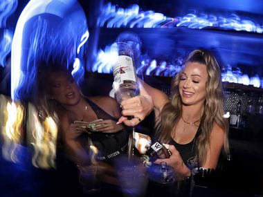 Markie Kinney mixes a drink at Citizen, which reopened at a new Dallas address on March 19, 2021.