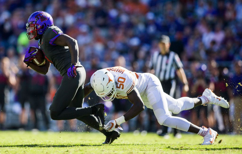 FILE - TCU wide receiver Jalen Reagor (1) evades Texas linebacker Byron Vaughns (50) during the second quarter of a game on Saturday, Oct. 26, 2019, at Amon G Carter Stadium in Fort Worth.