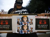 Shena Lee of Dallas displayed photos of Breonna Taylor during a Next Generation Action Network protest outside of Dallas Police Headquarters before they marched down S. Lamar St. in Dallas, Wednesday, September 23, 2020. A Kentucky grand jury brought no charges against the Louisville police for the killing of Taylor during a drug raid gone wrong.