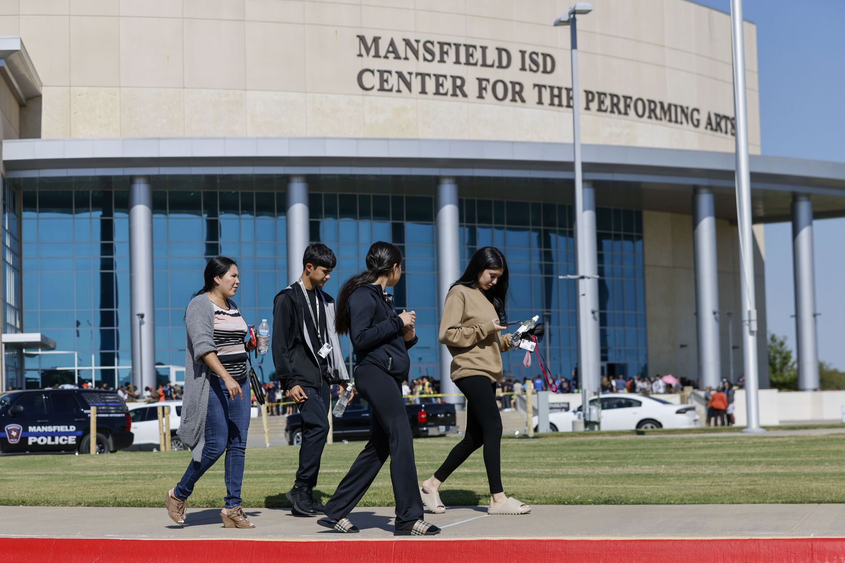 From left: Veronica Garza walks with her children, Jose Gonzalez, 15, Natalie Gonzalez, 16, and Deserae Gonzalez, 19, outside the Mansfield ISD Center for the Performing Arts.