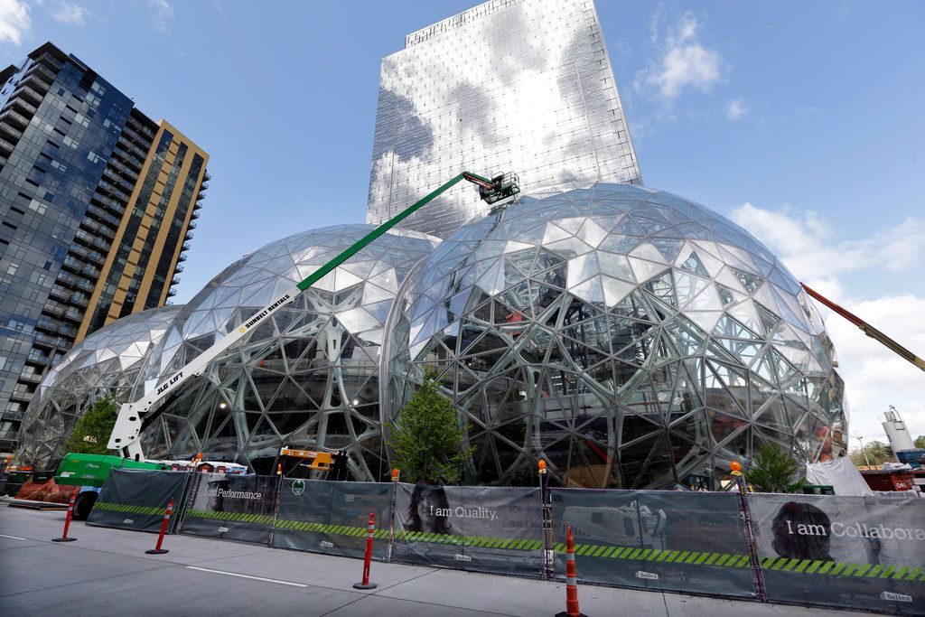 In this April 27, 2017 file photo, construction continues on three large, glass-covered domes as part of an expansion of the Amazon.com campus in downtown Seattle.