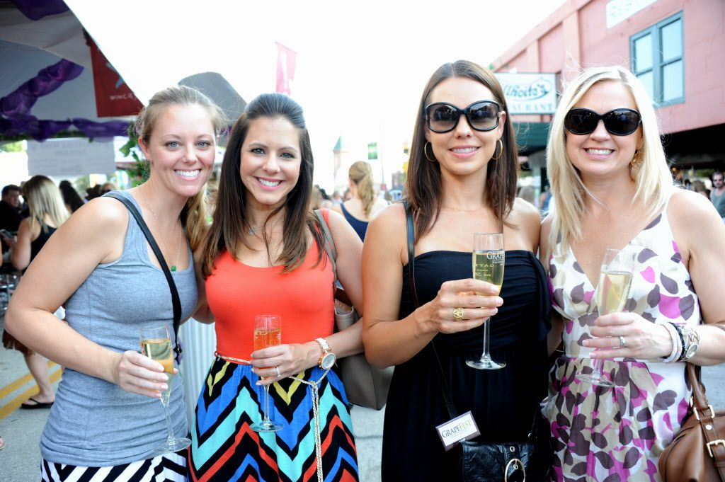Friends Bridget Cooper, Janel Cooper, Sherree Pence, and Angie Eusay sip white wine at the 27th Annual GrapeFest on Main Street in Grapevine, TX on September 14, 2013 in this file photo. (Alexandra Olivia/ Special Contributor)