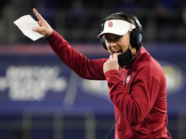 Oklahoma head coach Lincoln Riley calls in a play during the second half of the Cotton Bowl Classic against Florida at AT&T Stadium on Wednesday, Dec. 30, 2020, in Arlington.