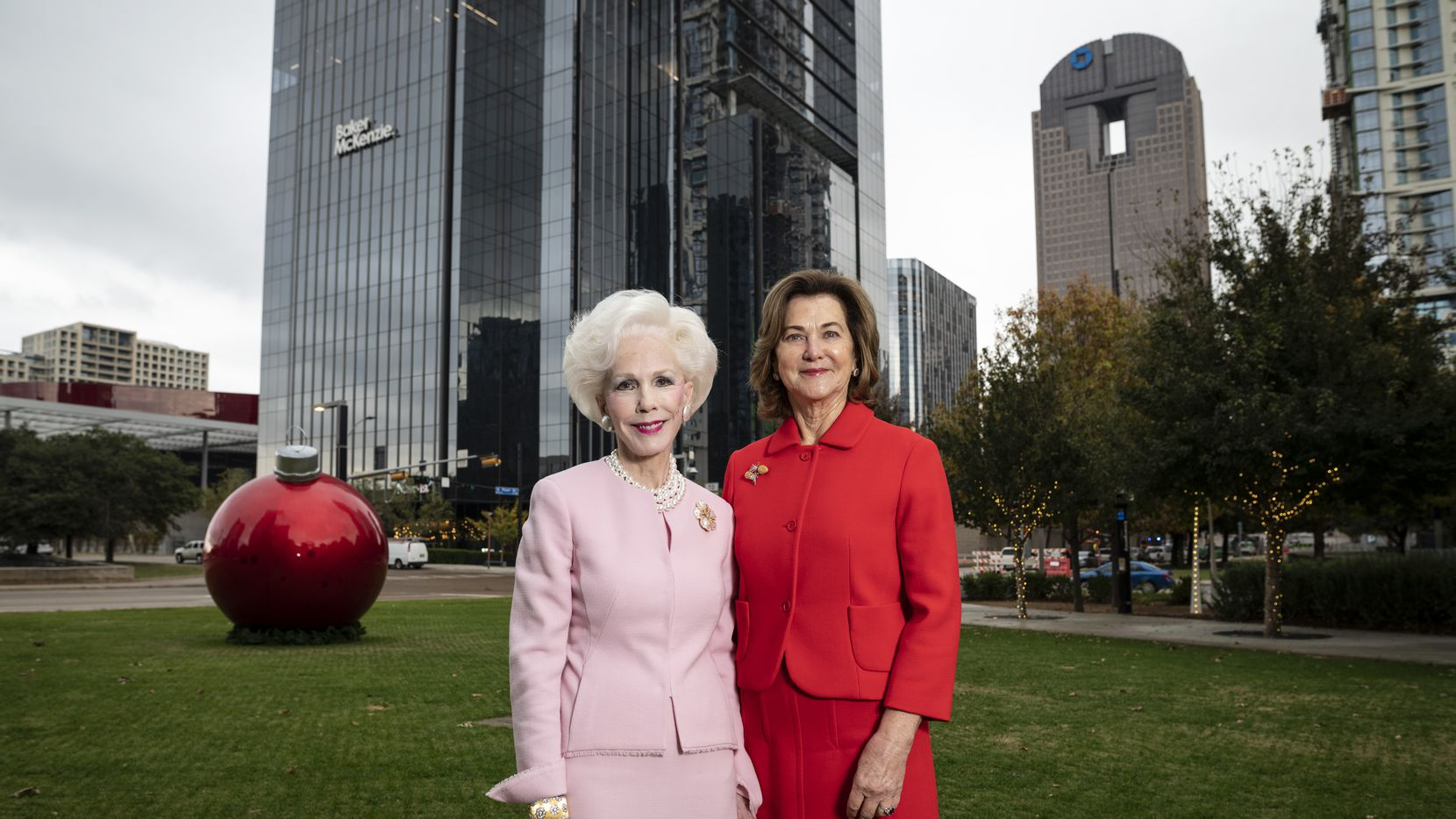 Sheila Grant, left, co-founder of the Klyde Warren Park board, and Nancy Best, fountain donor, stand where a new $10 million interactive fountain will be built at Klyde Warren Park in Dallas, on Dec. 2, 2020.