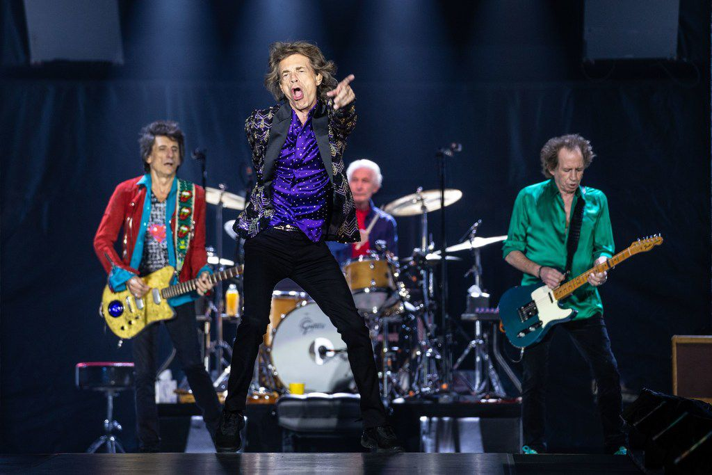 """The Rolling Stones band members (left to right) Ronnie Wood, Mick Jagger, Charlie Watts and Keith Richards perform on stage during their """"No Filter"""" tour at NRG Stadium on July 27, 2019 in Houston, Texas."""