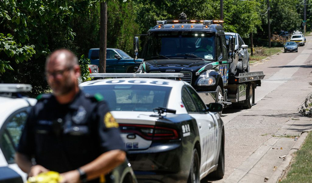 A Ford Fiesta was towed away as Dallas police worked the scene of the shooting on North Denley Drive on Friday.