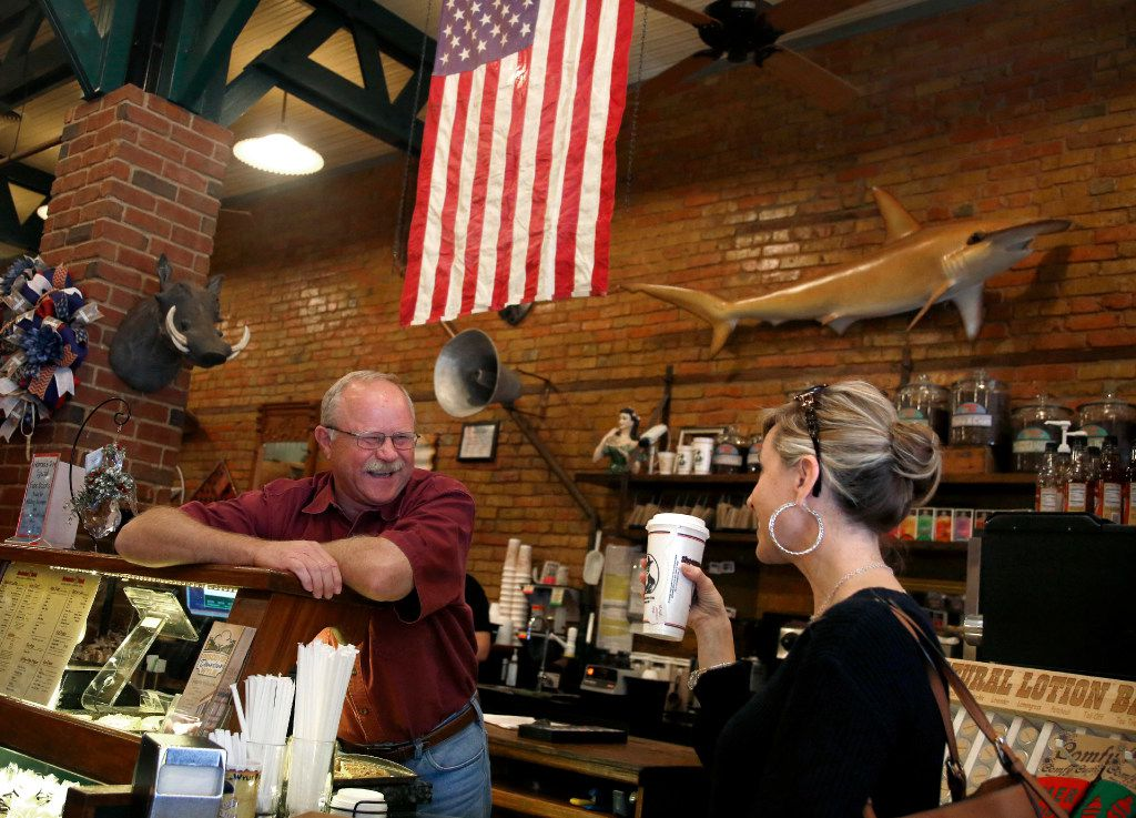 """Kent Crane, owner of Shoemaker & Hardt Coffee House and Country Store, and a Donald Trump voter, speaks with Missy Hefty, of Prosper, Texas, about the quality of the Chai tea latte they serve, Friday, Nov. 11, 2016 in Wylie, Texas. Hefty, a Wylie ISD employee on lunch break, said she loves their tea and always gets a """"ginormous"""" size to go. Hefty said she voted for Gary Johnson."""