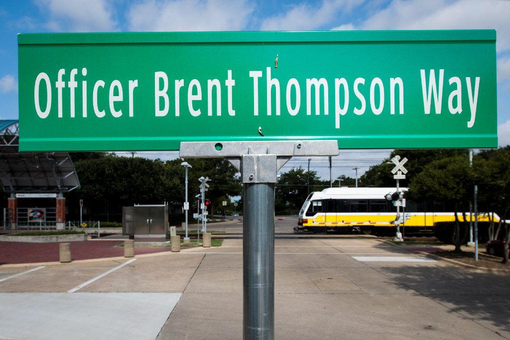 A street sign marks Officer Brent Thompson Way, which runs between the Illinois Station and DART Police headquarters. DART Police Chief James Spiller dedicated the street to Thompson at a memorial ceremony in May.