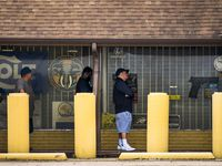 People lined up to get into Dallas-based Ray's Hardware and Sporting Goods, which sells guns and ammunition. Gun sales rose 80% in May compared to last year, according to Small Arms Analytics & Forecasting.