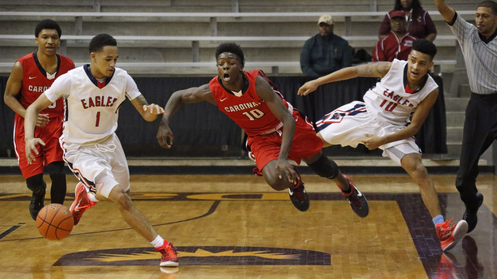 Humble Atascocita's Brandon Loville (1) and Greg Shead (10) pressured MacArthur's Andrew Jones (10) as he brought the ball up court in the fourth quarter of a Class 6A Region II playoff game in Dallas in March  2015.