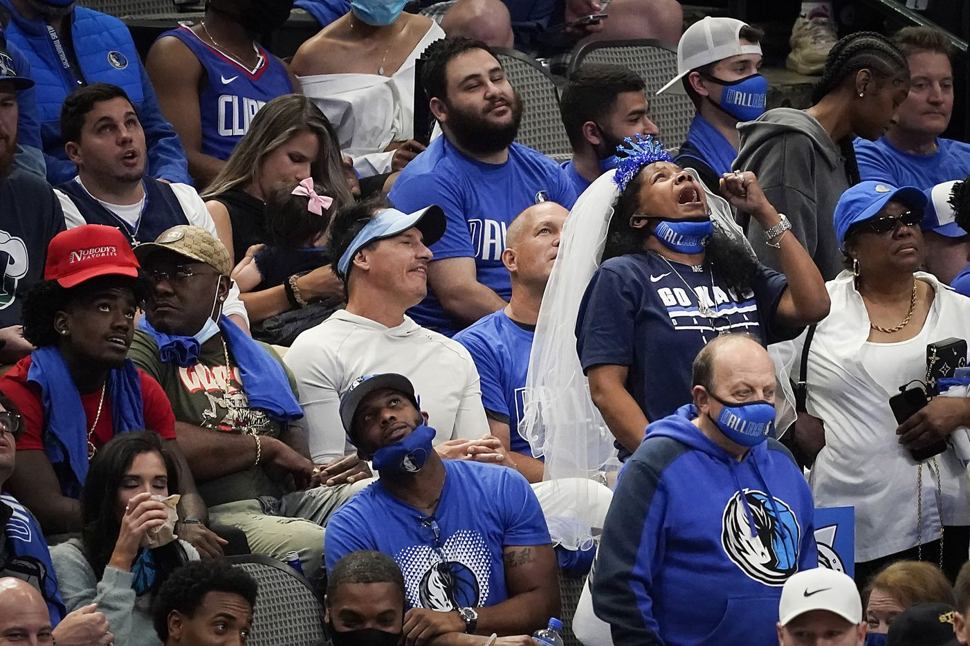 A Dallas Mavericks fan reacts to a play during the fourth quarter of an NBA playoff basketball game against the LA Clippers at American Airlines Center on Friday, May 28, 2021, in Dallas.