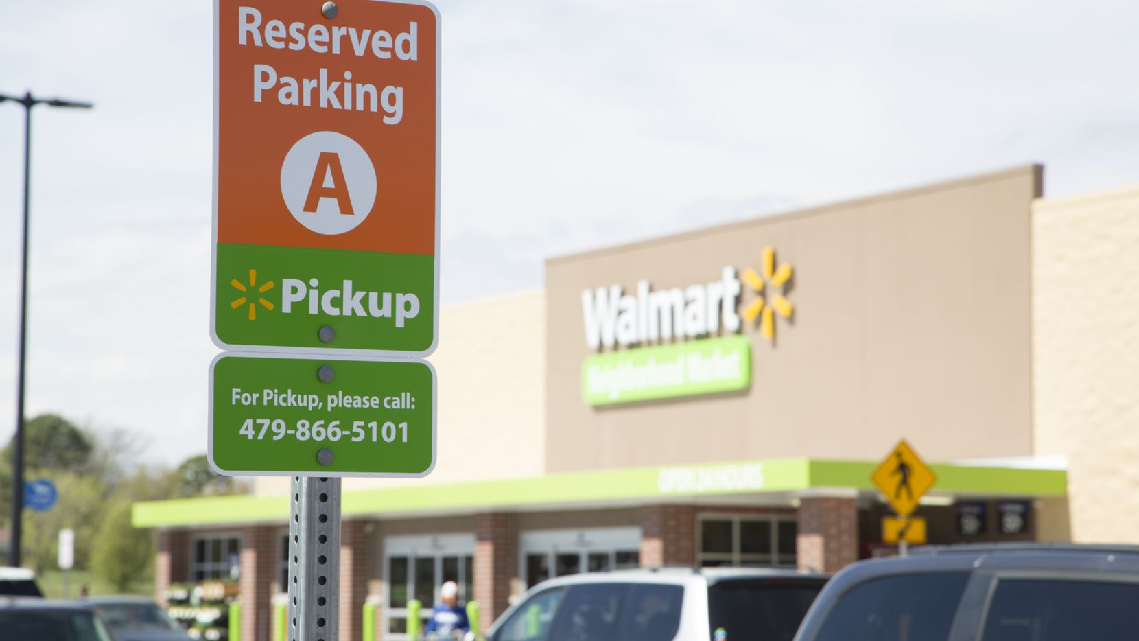 A curbside pickup parking space at a Walmart Neighborhood Market.