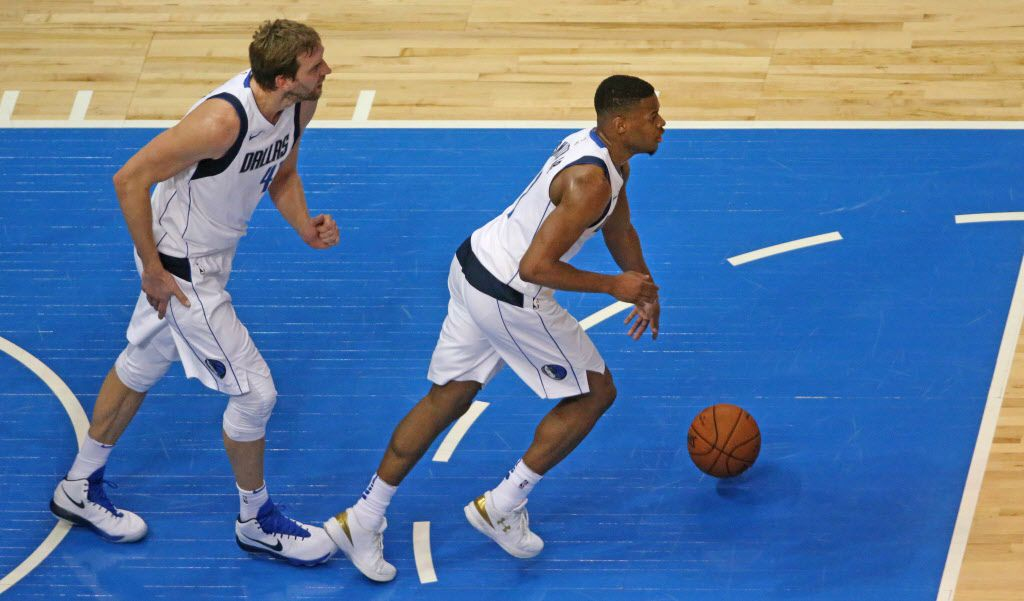 Dallas Mavericks forward Dirk Nowitzki (41) and guard Dennis Smith Jr. (1) are pictured during the Orlando Magic vs. the Dallas Mavericks NBA basketball game at the American Airlines Center in Dallas on Tuesday, January 9, 2018. (Louis DeLuca/The Dallas Morning News)