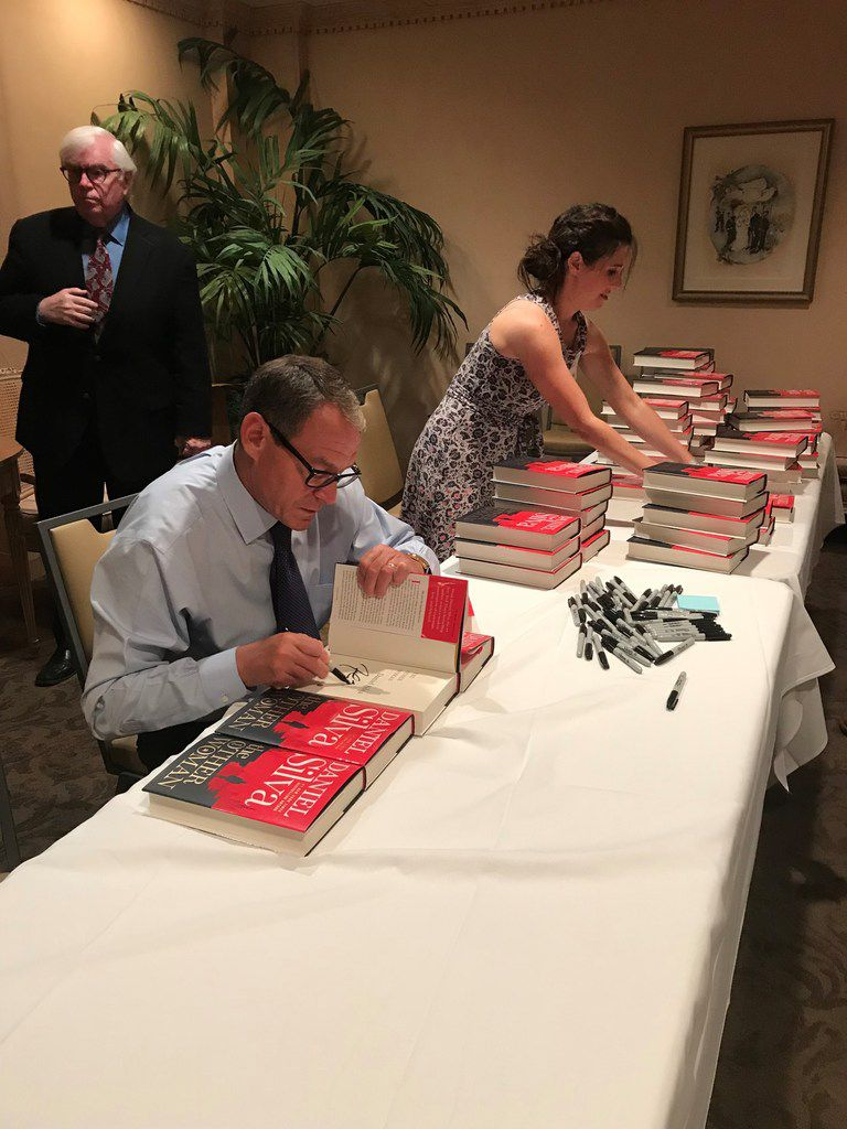 Best-selling author Daniel Silva signs more than 500 copies of his novel, The Other Woman, before an event at Congregation Shearith Israel, sponsored by the Jewish Community Center of Dallas, on  July 23, 2018.