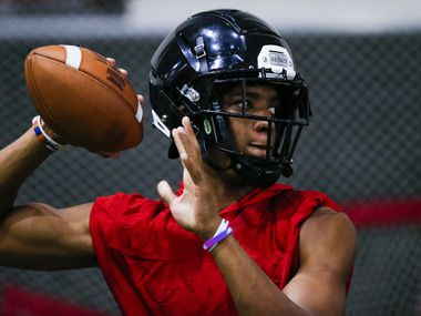Euless Trinity senior running back and quarterback Ollie Gordon throws during a varsity practice at Euless Trinity High School, Monday, August 9, 2021.