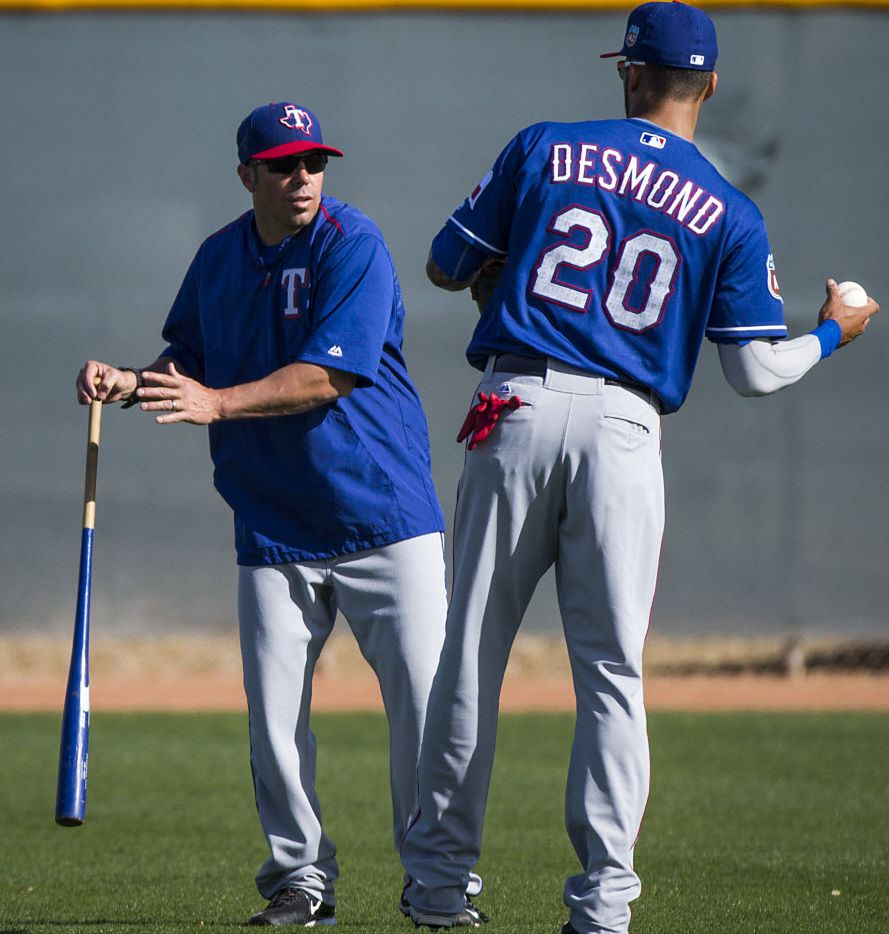 Texas Rangers outfielder Ian Desmond works with field coordinator Jayce Tingler during a spring workout at the team's training facility on Tuesday, March 1, 2016, in Surprise, Ariz. (Smiley N. Pool/The Dallas Morning News)