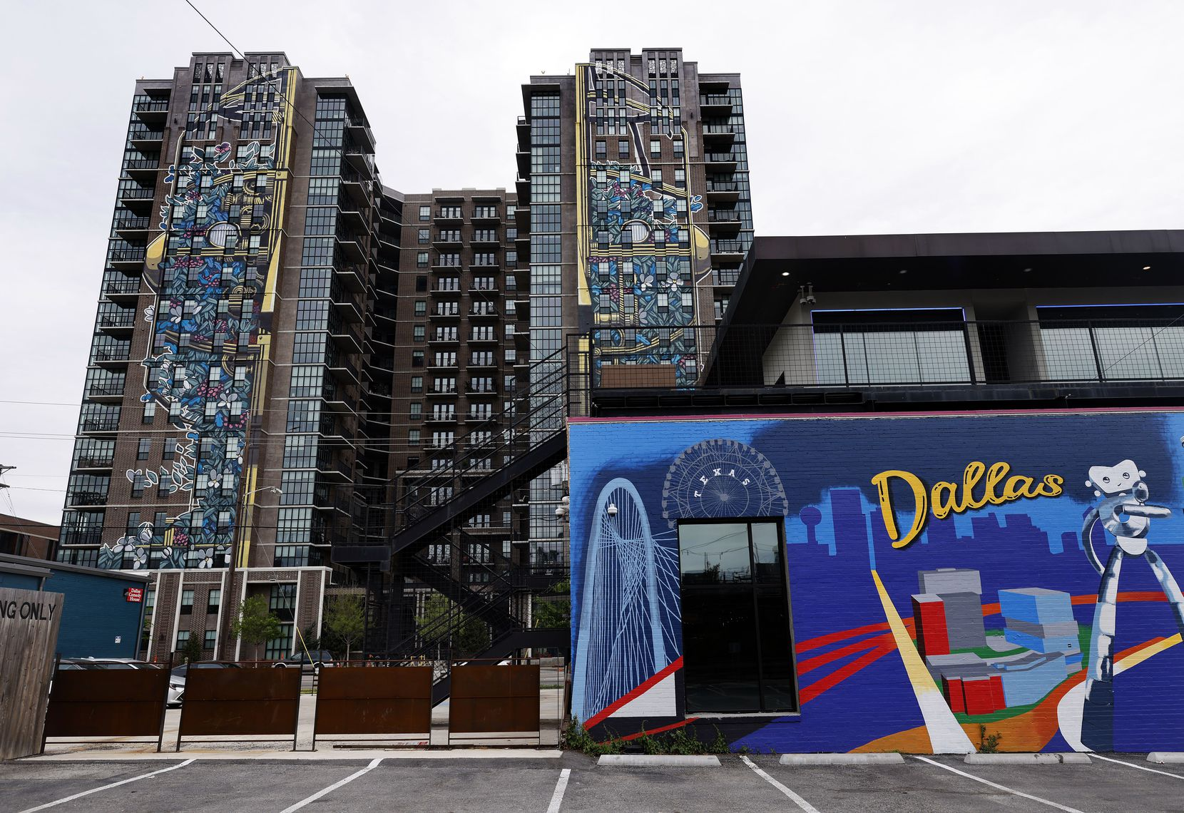 Large art murals run the length of the high-rise Case Building at 3131 Main St. in the Deep Ellum area of Dallas.