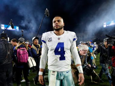 FILE — Dallas Cowboys quarterback Dak Prescott (4) seen after losing to the Los Angeles Rams in their NFC Divisional Playoff game Jan. 12, 2019. With his new contract, Prescott has gone from being the solution to part of the problem if the team's postseason fate doesn't change, and change quickly.