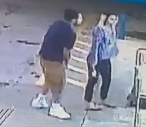 A still photo shows grainy images of two people suspected in an attack at a Fort Worth convenience store.