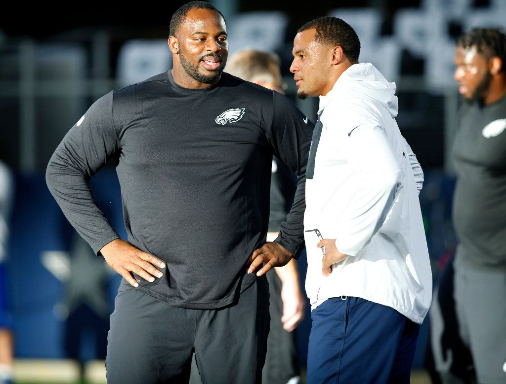 Dallas Cowboys quarterback Dak Prescott (right) visits with former Mississippi St. teammate and Philadelphia Eagles defensive tackle Fletcher Cox during warmups before their game with the Philadelphia Eagles game at AT&T Stadium in Arlington, Texas, Sunday, October 30, 2016.